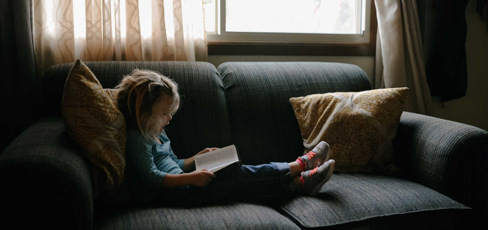 Girl reading in the sofa