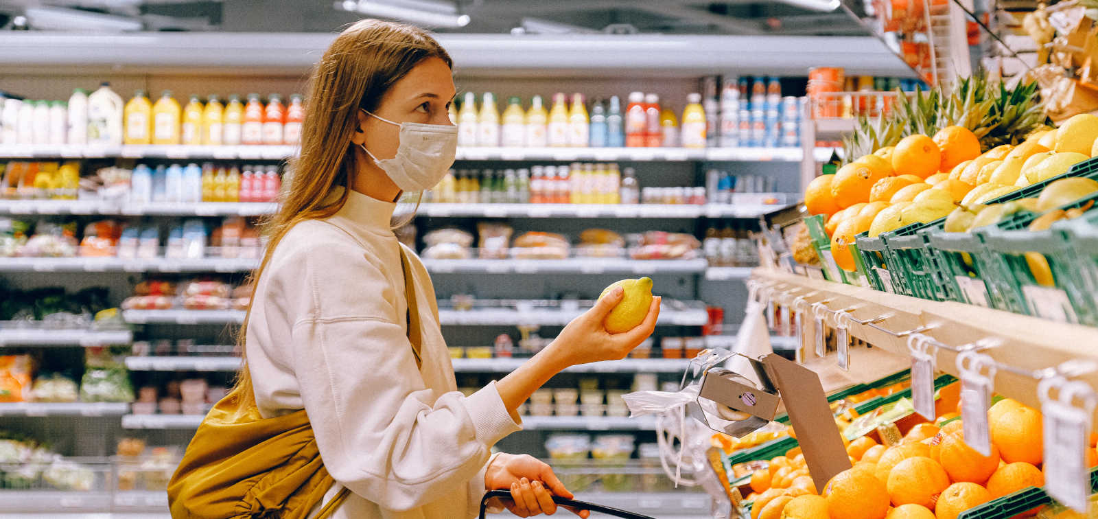 Women wearing a mask and buying